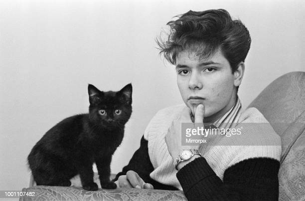 Portrait of rock and roll singer Cliff Richard with a cat, 3rd January 1959.
