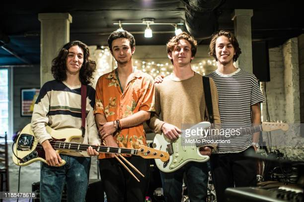 portrait of rock band in practice space - pop musician stock pictures, royalty-free photos & images