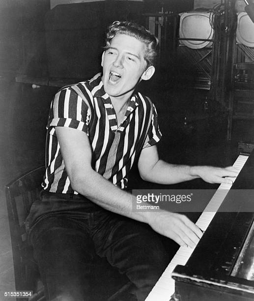 Portrait of rockandroll recording artist Jerry Lee Lewis He is shown seated at the piano singing