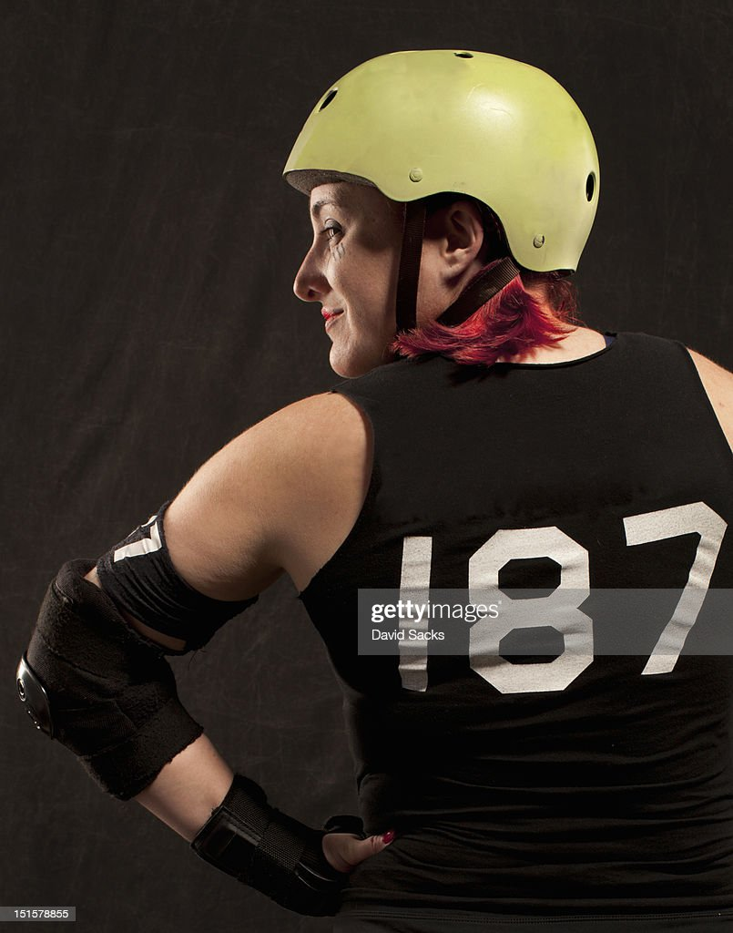 Portrait of roller derby woman from the back : Stock Photo