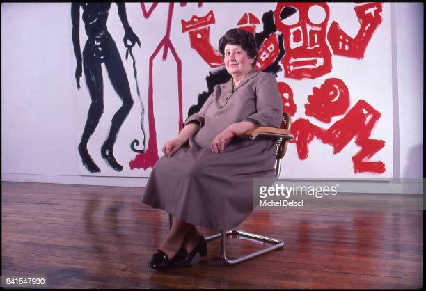 Portrait of Romanianborn American art dealer Ileana Sonnabend as she sits in her Soho gallery New York New York December 15 1982 Behind her is an...