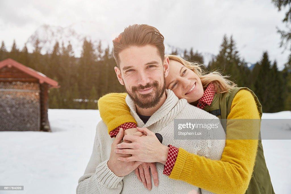 Portrait of romantic couple in snow, Elmau, Bavaria, Germany : Stock Photo