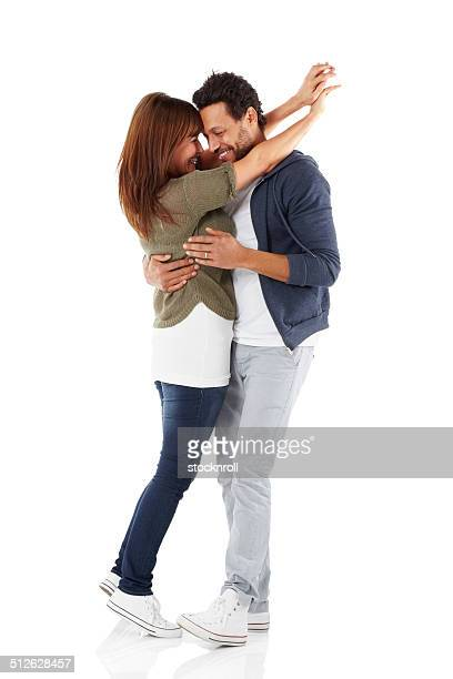 Portrait of romantic mixed race couple embracing