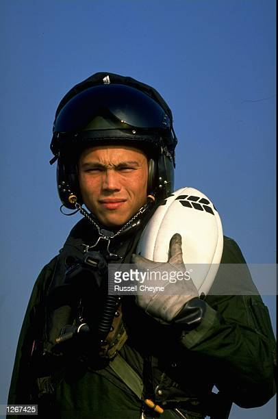 Portrait of Rory Underwood the England Winger and RAF Pilot in full flying gear holding a rugby ball at RAF Cranwell in England Mandatory Credit...