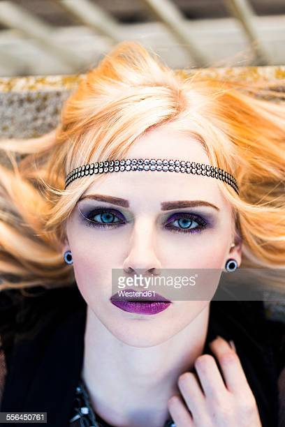 Portrait of rouged blond woman with hair-band