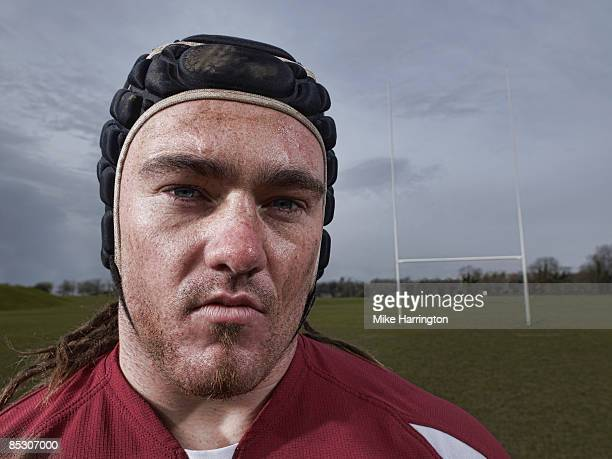 Portrait of rugby player on pitch