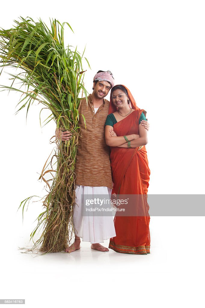 Portrait of rural couple with fodder : Stock Photo