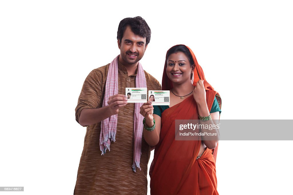 Portrait of rural couple with id cards : Stock Photo