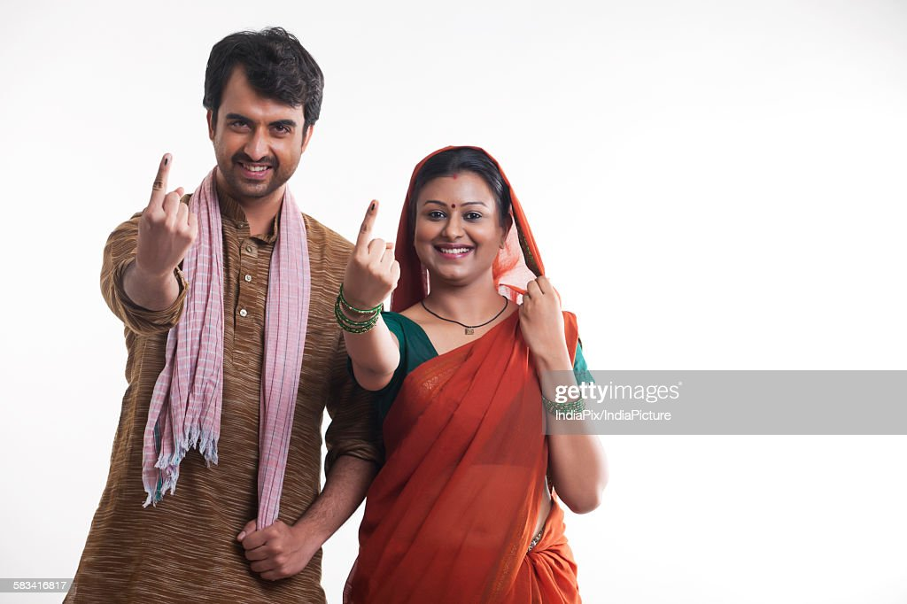 Portrait of rural couple with voters mark : Stock Photo