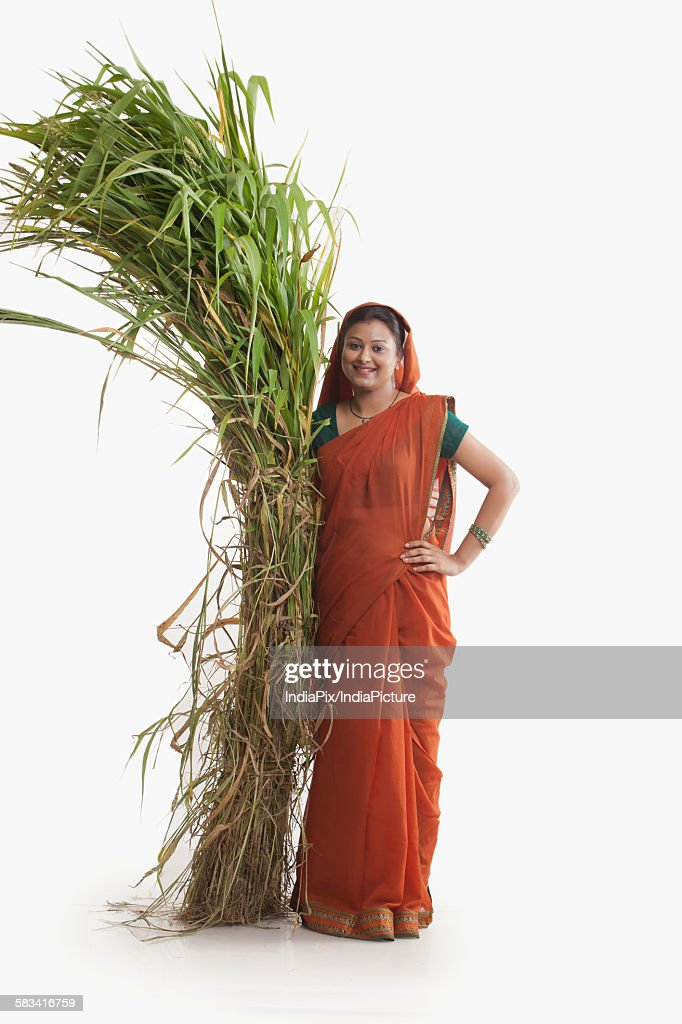 Portrait of rural woman with fodder : Stock Photo