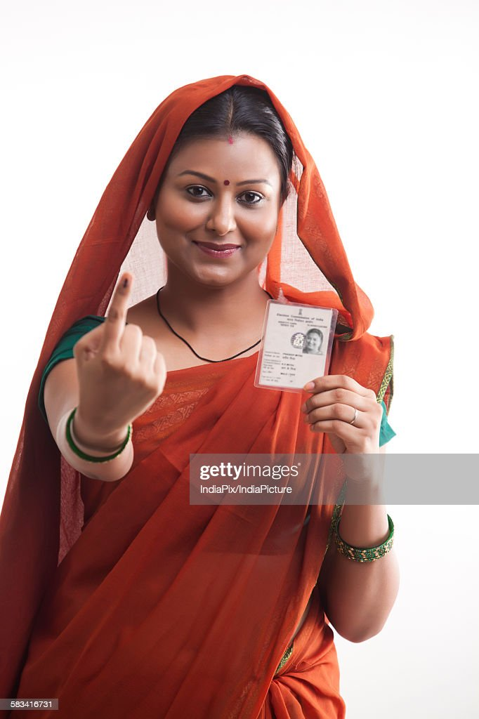 Portrait of rural woman with voters mark and identity card : Stock Photo