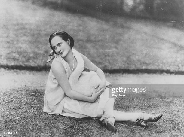 Portrait of Russian ballerina Anna Pavlova sitting on the grass outdoors circa 1925