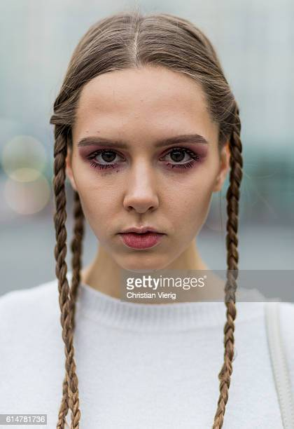 Portrait of Russian model Victoria with a white sweater and braid hair on October 14 2016 in Moscow Russia