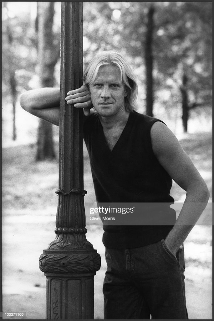 Portrait of Russian-American ballet dancer and actor Alexander Borisovich Godunov (1949 - 1995) as he leans against a lamppost in Central Park, New York, New York, mid 1980s.