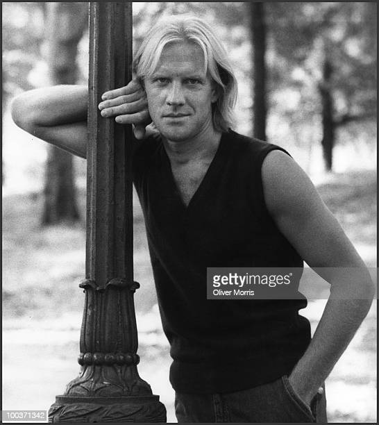 Portrait of RussianAmerican ballet dancer and actor Alexander Borisovich Godunov as he leans against a lamp post in Central Park New York New York...