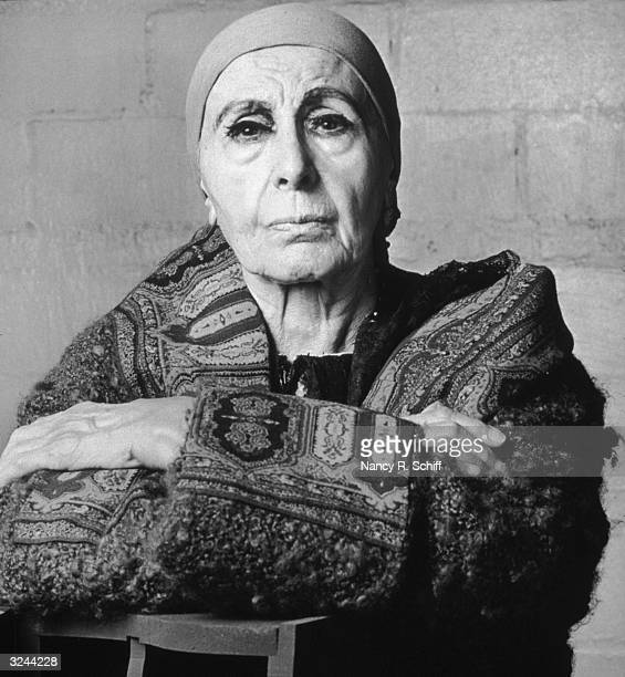 Portrait of Russianborn sculptor Louise Nevelson wearing a scarf around her hair and a woolly coat