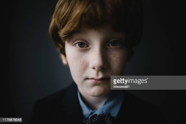 portrait of sad boy with freckles - only boys stock pictures, royalty-free photos & images