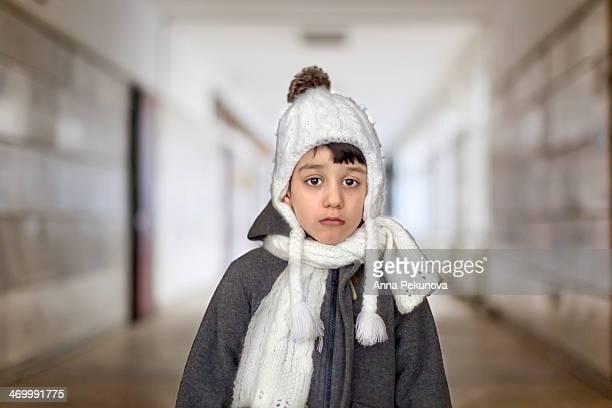 Portrait of sad boy with warm clothes