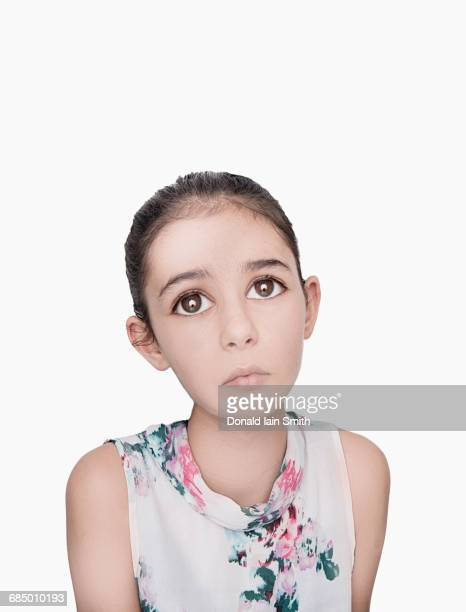 portrait of sad mixed race girl with big eyes - big eyes stock photos and pictures