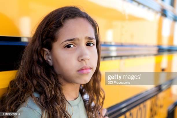 portrait of sad schoolgirl - sad stock pictures, royalty-free photos & images