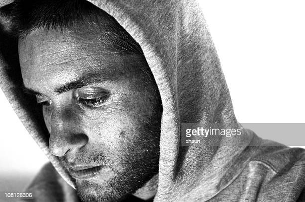 Portrait of Sad Young Man Wearing Hooded Sweatshirt