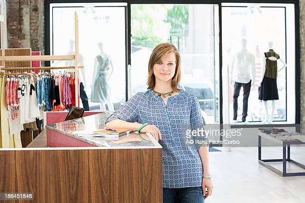 Portrait of sales clerk at boutique counter