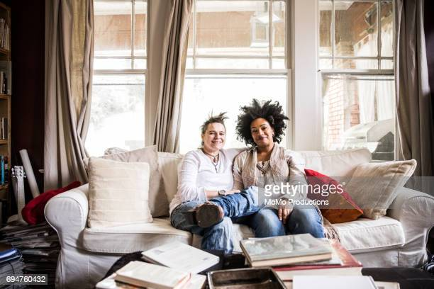 portrait of same-sex couple at home - printed media stock pictures, royalty-free photos & images