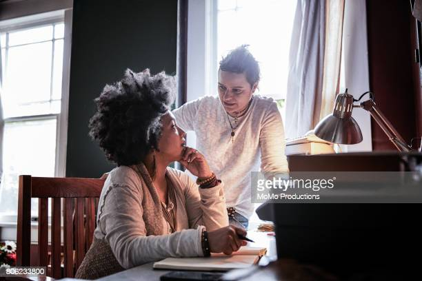 portrait of same-sex couple at home - lesbian stock pictures, royalty-free photos & images