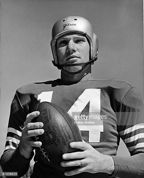 Portrait of San Francisco 49ers quarterback YA Tittle in uniform and holding a football 1950s