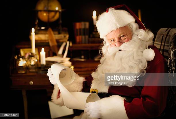 Portrait of Santa Claus reading childs letter