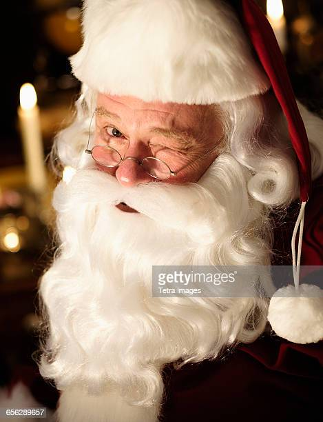 portrait of santa claus winking - naughty santa stock photos and pictures