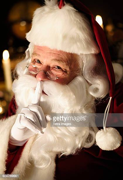 Portrait of Santa Claus with finger on lips