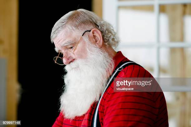 portrait of santas serious face - santa face stock photos and pictures