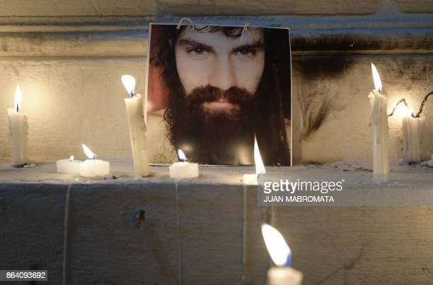 A portrait of Santiago Maldonado disappeared on August 1st during a Mapuche protest in Chubut province is surrounded by candles outside the judicial...