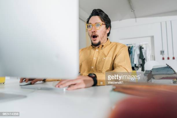 portrait of scared freelancer working on computer - surprise stock pictures, royalty-free photos & images
