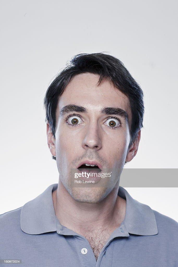 Portrait of scared man, studio shot : Stock-Foto