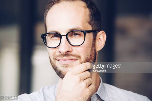 portrait of sceptical businessman wearing glasses - suspicion stock pictures, royalty-free photos & images