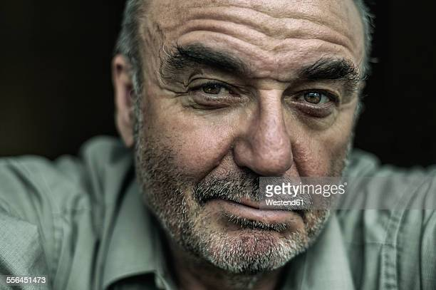 portrait of sceptical senior man - close up stock pictures, royalty-free photos & images