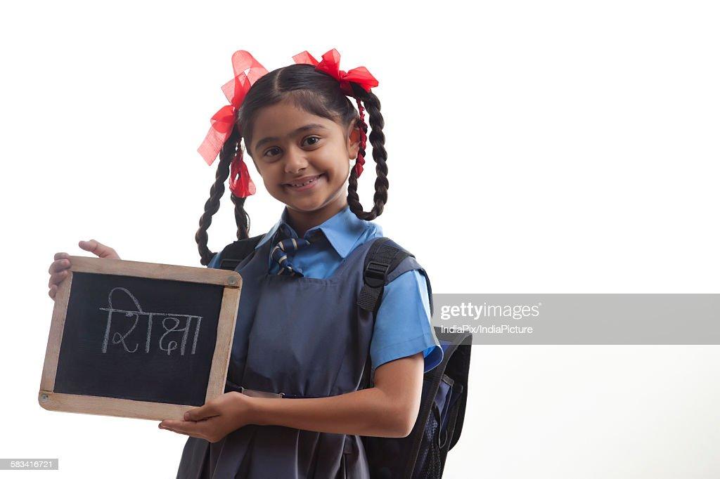 Portrait of school girl holding slate : Stock Photo