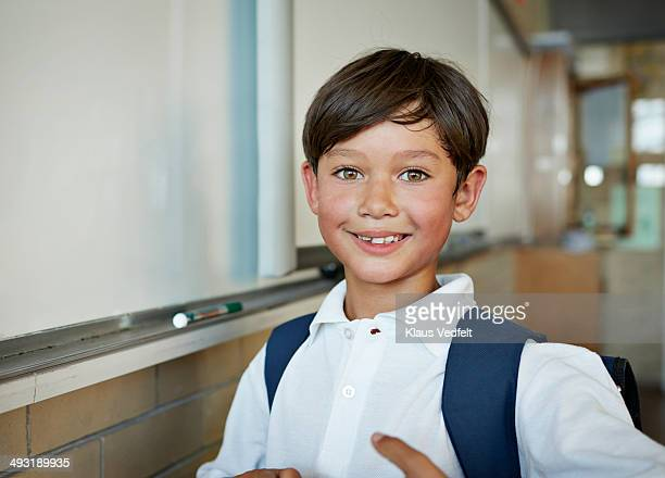 Portrait of schoolboy in classroom