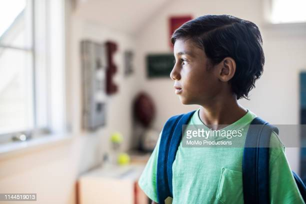 portrait of schoolboy in his bedroom - primary age child stock pictures, royalty-free photos & images