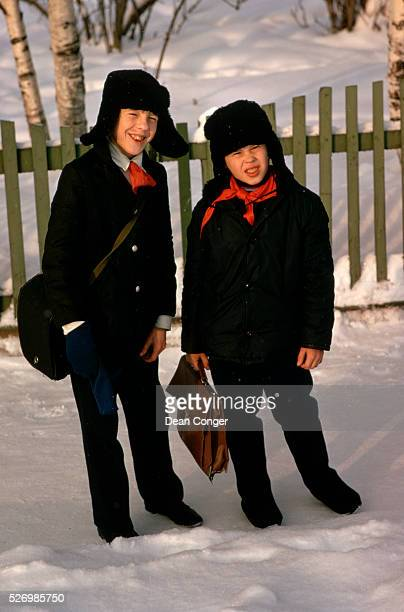Portrait of Schoolboys Travelling Home Through Snow