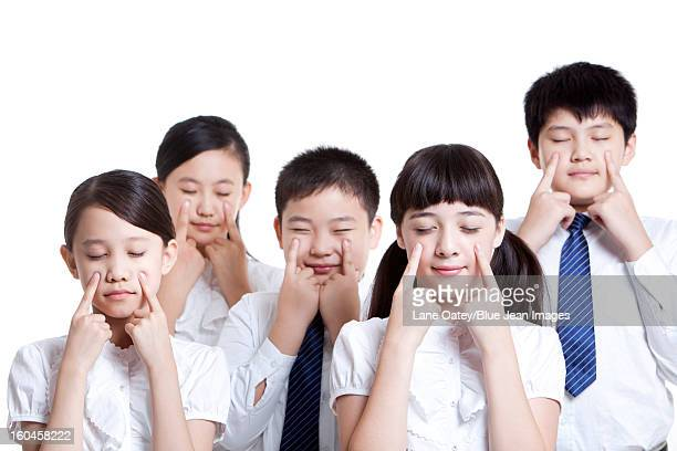 portrait of schoolchildren doing eye exercises - visual china group stock pictures, royalty-free photos & images