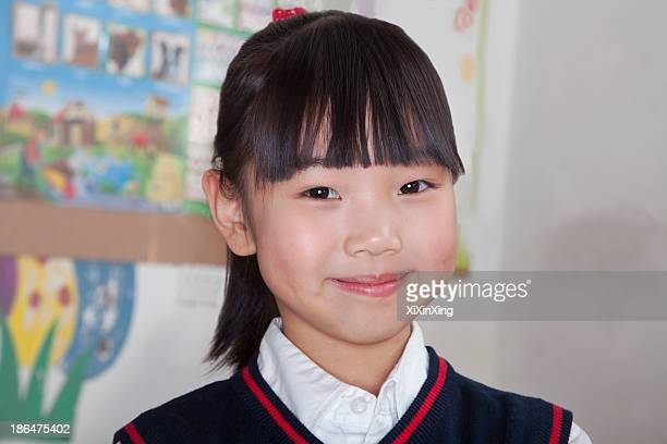 Portrait of schoolgirl in classroom, Beijing, China