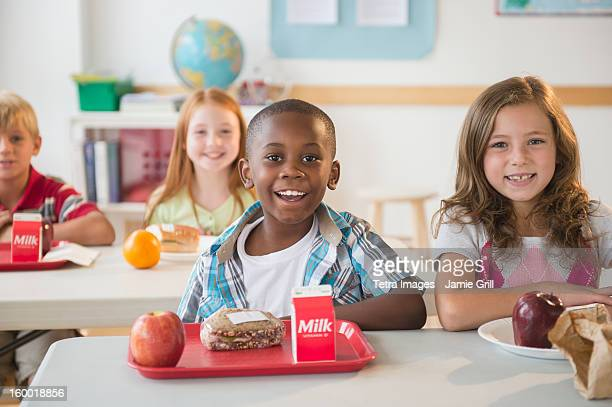 Portrait of schoolgirl (8-9) in classroom