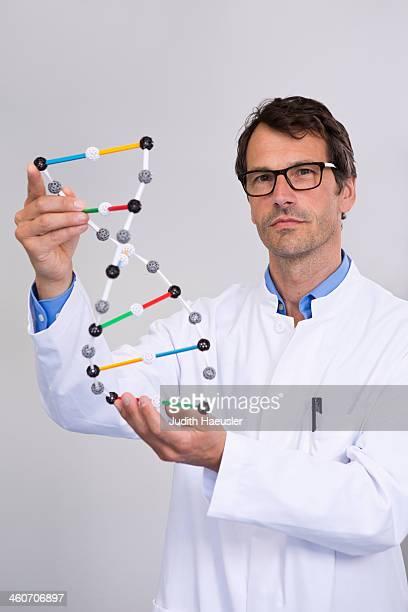 Portrait of scientist with dna molecular model