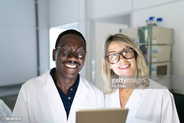 portrait of scientists working in a laboratory - 50 59 years stock pictures, royalty-free photos & images