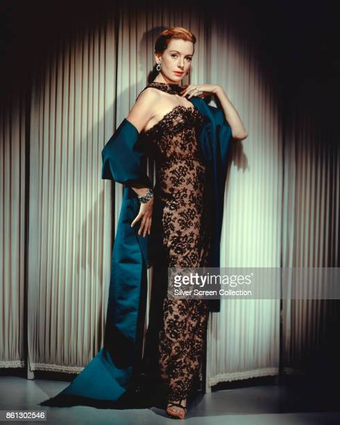 Portrait of Scottish actress Deborah Kerr in a black lace dress and a blue silk gown 1940s or 1950s