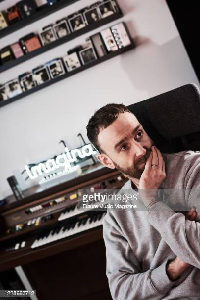 Portrait of Scottish musician Ross McNae, bassist and keyboardist with alternative rock group Twin Atlantic, photographed at the bands studio in...