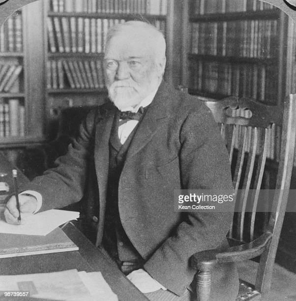 A portrait of ScottishAmerican industrialist Andrew Carnegie in the library of his home in New York city circa 1906